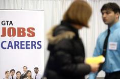 Visitors walk through the 2014 Spring National Job Fair and Training Expo in Toronto, April 3, 2014. REUTERS/Aaron Harris