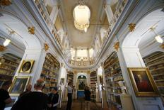 Visitors watch books at the Duchess Anna Amalia Library in Weimar August 15, 2014. REUTERS/Ralph Orlowski