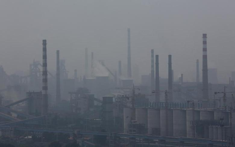 A steel factory is seen in smog during a hazy day in Anshan, Liaoning province, June 29, 2014. REUTERS/Stringer