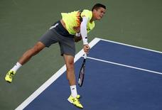 Milos Raonic of Canada serves to Peter Gojowczyk of Germany during their match at the 2014 U.S. Open tennis tournament in New York, August 28, 2014.   REUTERS/Mike Segar