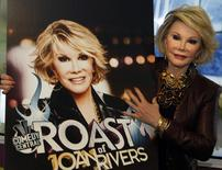 "Joan Rivers poses for photographers as she presents ""Comedy Roast with Joan Rivers"" at the annual MIPCOM television programme market in Cannes, southeastern France, October 6, 2009.   REUTERS/Eric Gaillard"