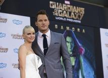 """Cast member Chris Pratt and his wife, actress Anna Faris pose at the premiere of """"Guardians of the Galaxy"""" in Hollywood, California July 21, 2014. REUTERS/Mario Anzuoni"""