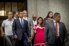 Former SAC Capital Advisors portfolio manager Mathew Martoma (C) exits the U.S. District Court for the Southern District of New York with his wife Rosemary (center R ), following sentencing for insider trading, in Lower Manhattan September 8, 2014.   REUTERS/Brendan McDermid