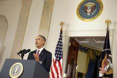 Президент США Барак Обама выступает в Белом доме в Вашингтоне 10 сентября 2014 года.  Президент США Барак Обама сказал американцам в среду, что одобрил авиаудары по Сирии и расширение боевых действий в Ираке в рамках кампании против боевиков организации Исламское государство. REUTERS/Saul Loeb/Pool