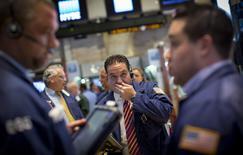 Traders work on the floor of the New York Stock Exchange August 26, 2014. REUTERS/Brendan McDermid/Files