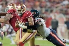 Sep 14, 2014; Santa Clara, CA, USA; San Francisco 49ers quarterback Colin Kaepernick (7) is sacked by Chicago Bears defensive end Willie Young (97) during the fourth quarter at Levi's Stadium. The Chicago Bears defeated the San Francisco 49ers 28-20. Mandatory Credit: Ed Szczepanski-USA TODAY Sports