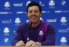 European Ryder Cup player Rory McIlroy smiles during a news conference ahead of the 2014 Ryder Cup at Gleneagles in Scotland September 24, 2014. REUTERS/Eddie Keogh