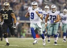 Sep 28, 2014; Arlington, TX, USA; Dallas Cowboys quarterback Tony Romo (9) runs for a first down int he third quarter against the New Orleans Saints at AT&T Stadium. Matthew Emmons-USA TODAY Sports