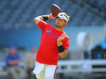 Sep 7, 2014; Chicago, IL, USA; Buffalo Bills quarterback Kyle Orton (18) warms up prior to a game against the Chicago Bears at Soldier Field. Mandatory Credit: Dennis Wierzbicki-USA TODAY Sports