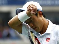 Kei Nishikori of Japan wipes his face during the men's singles final match against Marin Cilic of Croatia at the 2014 U.S. Open tennis tournament in New York, September 8, 2014. REUTERS/Adam Hunger