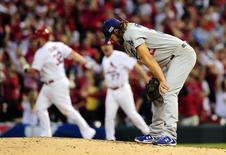 Oct 7, 2014; St. Louis, MO, USA; Los Angeles Dodgers starting pitcher Clayton Kershaw (22) reacts after giving up a three-run home run to St. Louis Cardinals first baseman Matt Adams (32) in the 7th inning during game four of the 2014 NLDS baseball playoff game at Busch Stadium. Jeff Curry-USA TODAY Sports