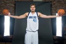 Sep 29, 2014; Dallas, TX, USA; Dallas Mavericks forward Dirk Nowitzki (41) poses for a portrait during media day at the American Airlines Center. Mandatory Credit: Jerome Miron-USA TODAY Sports