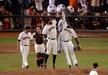 Oct 25, 2014; San Francisco, CA, USA; San Francisco Giants players from left Hunter Strickland, Buster Posey , Brandon Belt and Pablo Sandoval celebrate after defeating the Kansas City Royals during game four of the 2014 World Series at AT&T Park. Mandatory Credit: Kelley L Cox-USA TODAY Sports