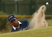 Anirban Lahiri of the India hits out of a bunker on the second hole during a practice round ahead of the British Open Championship at the Royal Liverpool Golf Club in Hoylake, northern England July 16, 2014.   REUTERS/Cathal McNaughton