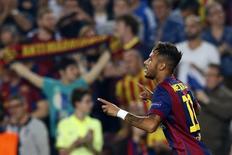Jogador brasileiro Neymar, do Barcelona, comemora gol marcado contra o Ajax Amsterdã, durante partida pela Liga dos Campeões, no estádio Camp Nou, em Barcelona. 21/10/2014. REUTERS/Albert Gea
