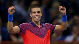 Borna Coric of Croatia reacts after winning his match against Spain's Rafael Nadal at the Swiss Indoors ATP tennis tournament in Basel October 24, 2014.    REUTERS/Arnd Wiegmann