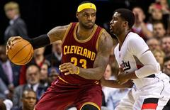 Nov 4, 2014; Portland, OR, USA; Cleveland Cavaliers forward LeBron James (23) posts up against Portland Trail Blazers guard Wesley Matthews (2) during the second quarter at the Moda Center. Mandatory Credit: Craig Mitchelldyer-USA TODAY Sports