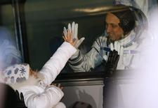 International Space Station (ISS) crew Anton Shkaplerov of Russia matches palm with his daughter Kira from a bus window before the launch of the Soyuz-FG rocket at the Baikonur cosmodrome November 23, 2014. REUTERS/Dmitry Lovetsky/Pool