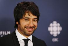 Jian Ghomeshi arrives on the red carpet at the 2014 Canadian Screen awards in Toronto, March 9, 2014. REUTERS/Mark Blinch