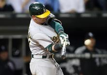 Sep 9, 2014; Chicago, IL, USA; Oakland Athletics third baseman Josh Donaldson hits a two-run double against the Chicago White Sox during the fifth inning at U.S Cellular Field. Mandatory Credit: Jerry Lai-USA TODAY Sports - RTR45LP7