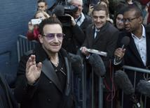 Irish band U2's lead singer, Bono, leaves the recording of the Band Aid 30 charity single in west London  November 15, 2014. REUTERS/Neil Hall