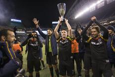 Nov 30, 2014; Seattle, WA, USA; Los Angeles Galaxy forward Robbie Keane (7) holds the trophy after winning the Western Conference Championship against the Seattle Sounders FC at CenturyLink Field. Mandatory Credit: Joe Nicholson-USA TODAY Sports