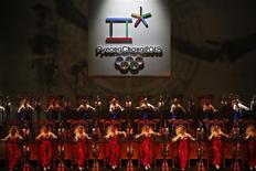 Traditional drum dancers perform as the emblem of the PyeongChang 2018 Olympic Winter Games is seen (top) during its Launch Ceremony in Seoul May 3, 2013. REUTERS/Kim Hong-Ji