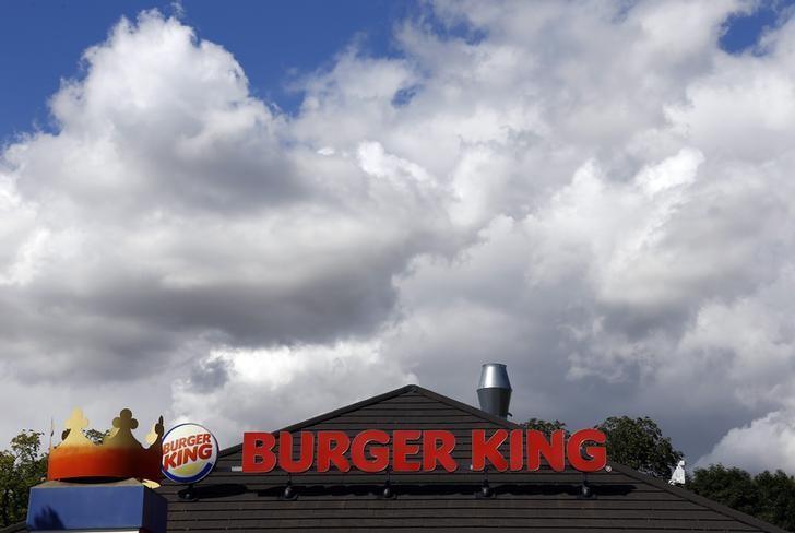 The logo of a Burger King fast food restaurant is seen at the chain's branch in Hanau, August 29, 2014. REUTERS/Kai Pfaffenbach