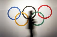 A man walks past the Olympic rings before the opening of the 127th International Olympic Committee (IOC) session in Monaco December 8, 2014.  REUTERS/Eric Gaillard