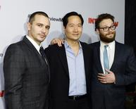 """Cast members James Franco (L), Charles Rahi Chun (C) and Seth Rogen pose during premiere of the film """"The Interview"""" in Los Angeles, California December 11, 2014.  REUTERS/Kevork Djansezian"""