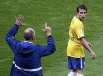 Brazil's coach Luiz Felipe Scolari (L) gestures to Bernard during their 2014 World Cup semi-final against Germany at the Mineirao stadium in Belo Horizonte July 8, 2014. REUTERS/David Gray