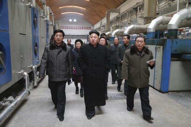 North Korean leader Kim Jong Un (front C) gives field guidance at the Kim Jong Suk Pyongyang Textile Mill in this undated photo released by North Korea's Korean Central News Agency (KCNA) in Pyongyang December 20, 2014.   REUTERS/KCNA