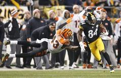 Dec 28, 2014; Pittsburgh, PA, USA; Pittsburgh Steelers wide receiver Antonio Brown (84) runs past Cincinnati Bengals strong safety George Iloka (43) to score a sixty-three yard touchdown during the fourth quarter at Heinz Field. Charles LeClaire-USA TODAY Sports
