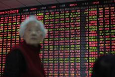 La Bourse de Shanghai a enregistré en 2014 la meilleure performance des grandes Bourses mondiales avec un gain de plus de 50% qui lui fait oublier plusieurs années de vaches maigres. /Photo prise le 31 décembre 2014/REUTERS/Aly Song
