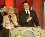 "Actress Donna Douglas and actor Max Baer, who starred as Ellie Mae and Jethro on ""The Beverly Hillbillies"" sing the shows theme song during an opening number during a taping of the second annual TV Land Awards in Hollywood March 7, 2004. REUTERS/Fred Prouser"