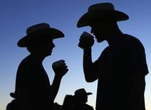 Country music fans drink beer as night falls during the final day of the Stagecoach country music festival in Indio, California April  27, 2014.   REUTERS/Mike Blake