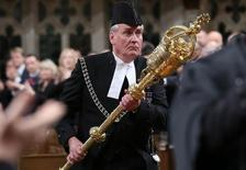 Sergeant-at-Arms Kevin Vickers is applauded in the House of Commons in Ottawa October 23, 2014. REUTERS/Chris Wattie
