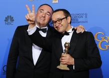 "Producer Alexander Rodnyansky (L) and director Andrey Zvyagintsev pose backstage with their award for Best Foreign Language Film for their film ""Leviathan"" at the 72nd Golden Globe Awards in Beverly Hills, California January 11, 2015.   REUTERS/Mike Blake"