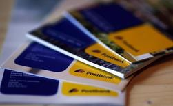 An illustration picture shows brochures of the Postbank AG  on a table in Munich November 14, 2012.     REUTERS/Michael Dalder