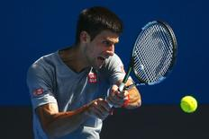 Serbia's Novak Djokovic hits a shot during a practice session on Rod Laver Arena at Melbourne Park January 18, 2015. The Australian Open tennis tournament begins on January 19. REUTERS/Athit Perawongmetha