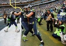 January 18, 2015; Seattle, WA, USA; Seattle Seahawks wide receiver Jermaine Kearse (15) celebrates with tight end Luke Willson (82) after catching the game winning touchdown pass against the Green Bay Packers during the overtime period for the 29-22 victory in the NFC Championship game at CenturyLink Field. Joe Nicholson-USA TODAY Sports
