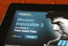 Amazon va produire et acquérir des films originaux destinés aux salles de cinéma qui seront ensuite distribués à ses abonnés via son service Prime Instant Video. /Photo d'archives/REUTERS/Sam Mircovich