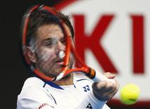 Stan Wawrinka of Switzerland hits a return to Marsel Ilhan of Turkey during their men's singles first round match at the Australian Open 2015 tennis tournament in Melbourne January 20, 2015. REUTERS/Athit Perawongmetha