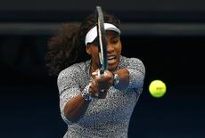 Serena Williams of the U.S. hits a shot during a practice session on Rod Laver Arena at Melbourne Park January 15, 2015.  REUTERS/David Gray
