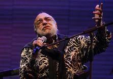 Greek singer Demis Roussos performs at the Edineyat international festival in Ehden town, northern Lebanon August 10, 2013.    REUTERS/Jamal Saidi