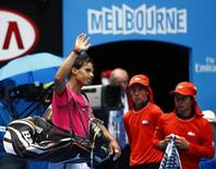 Rafael Nadal of Spain waves to the crowd after being defeated by Tomas Berdych of the Czech Republic in their men's singles quarter-final match at the Australian Open 2015 tennis tournament in Melbourne January 27, 2015. REUTERS/Issei Kato