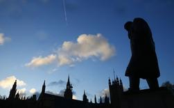 The statue of Britain's former Prime Minister Winston Churchill is silhouetted in front of the Houses of Parliament in London, January 30, 2015. REUTERS/Eddie Keogh