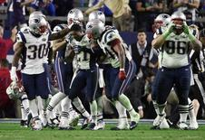 Feb 1, 2015; Glendale, AZ, USA; New England Patriots strong safety Malcolm Butler (21) celebrates with teammates after intercepting a pass against the Seattle Seahawks in the fourth quarter in Super Bowl XLIX at University of Phoenix Stadium. Kyle Terada-USA TODAY Sports