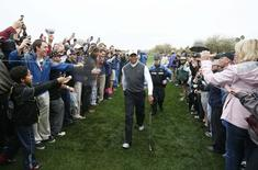 Tiger Woods walks through the gallery after recording the worst round of his professional career, carding an 11-over-par 82 during the second round of the Waste Management Phoenix Open at TPC Scottsdale. Jan 30, 2015; Scottsdale, AZ, USA;  Rob Schumacher-Arizona Republic via USA TODAY Sports