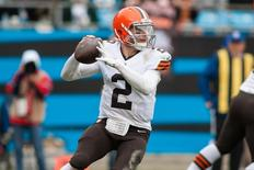 Dec 21, 2014; Charlotte, NC, USA;  Cleveland Browns quarterback Johnny Manziel (2) prepares to throw the ball during the second quarter against the Carolina Panthers at Bank of America Stadium. Mandatory Credit: Jeremy Brevard-USA TODAY Sports